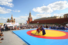 The young fighters are locked in Mongolian wrestling Stock Images
