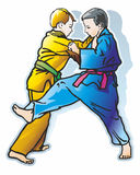 Young fighters. Sparring two young rivals judo fighters in the blue and yellow kimono Stock Images