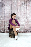 Young figure skater tying her skates Royalty Free Stock Photos