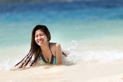 Young Filipina woman swimming Royalty Free Stock Image