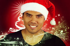 Young Filipino with a hat of Santa Claus. On a red background royalty free illustration