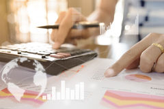 Free Young Finance Market Analyst Working At Office At White Table.Businessman Analyze Document And The Calculator In Hands Royalty Free Stock Photography - 98797537