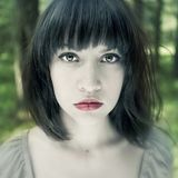 Young fine woman in forest Stock Photography