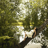 Young fine woman on tree Royalty Free Stock Photo