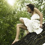 Young fine woman on tree Stock Photo