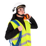 Young firefighter. A picture of a young firefighter in a white helmet looking against white background Stock Photo