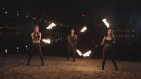 Young fireshow artists juggling fire poi outdoor stock video footage