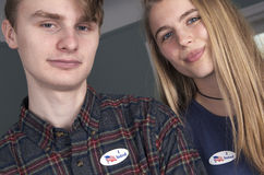 Young First Time Voters. Guy and girl age 18 and 19 wearing their I Voted sticker, as they have voted for the first time and are the youngest of legal votersnnnn Stock Photography