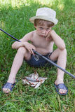 Young fisherman Stock Images