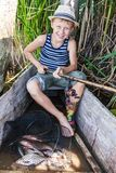 Young fisherman with a catch Stock Photography