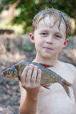 Young fisherman caught a bream Stock Images