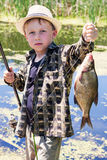 Young fisherman caught a bream Stock Photography