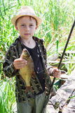 Young fisherman caught a bream Royalty Free Stock Image