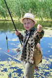 Young fisherman caught a bream Royalty Free Stock Images