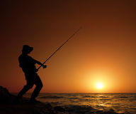 Young fisherman fishing Royalty Free Stock Photos