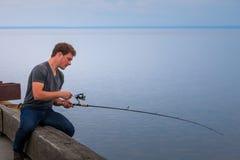 Young Fisherman Fishing Mackerel stock image