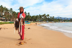 Young fisherman with his catch on Nacpan beach, Palawan Royalty Free Stock Photography