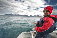 Young fisherman in Norway royalty free stock photo