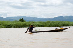 Young fisherman out for the morning fish on inlay lake. Burma Royalty Free Stock Images