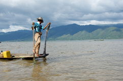 Young fisherman out for the morning fish on inlay lake. Burma Stock Images