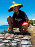 Young fisherman,philippines 2. A young,fisherman laying out his catch to dry in the sun on the island of camiguin in the southern philippines Stock Photos