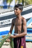 A young fisherman in Sri Lanka. stock photography
