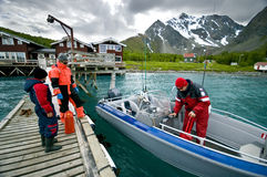 Young fishermen. Three young fishermen about to set off to fish in a Norwegian fjord Royalty Free Stock Image