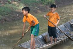 Young fishing boys are having pleasure in the Mekong river in Laos Royalty Free Stock Image