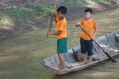 Young fishing boys are gaming and fishing at Mekong river in Laos Royalty Free Stock Photos