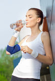 Young fit activity woman drinking water Stock Photos