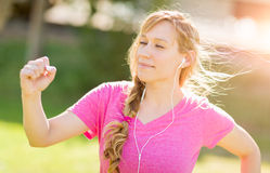 Young Fit Adult Woman Outdoors During Workout Listening To Music Royalty Free Stock Image