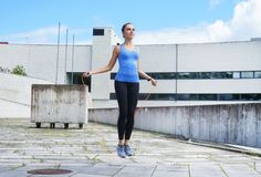 Free Young, Fit And Sporty Girl Jumping With A Skipping Rope. Royalty Free Stock Image - 112800416