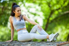 Young girl posing outdoor in her sportswear royalty free stock photo