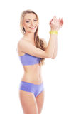 A young and fit blond woman in blue lingerie Stock Photos