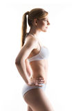 Young and fit blond woman in sporty lingerie Royalty Free Stock Photography