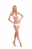A young and fit blond woman in white lingerie Royalty Free Stock Images