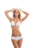 A young and fit blond woman in a white swimsuit Royalty Free Stock Photos