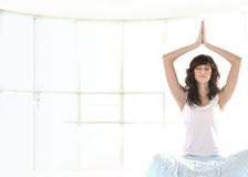 A young and fit brunette meditating Royalty Free Stock Photos