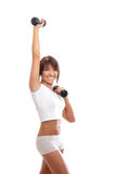 A young and fit brunette training with dumbbells Stock Photography