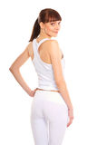 A young and fit brunette in white sporty clothes Stock Photography