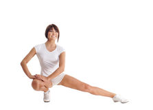 A young and fit brunette woman stretching her legs Royalty Free Stock Photos