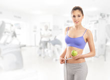 A young and fit Caucasian woman holding an apple Stock Photos