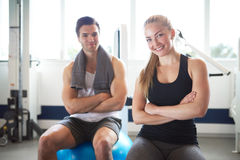 Young Fit Couple Inside the Gym Smiling at Camera Royalty Free Stock Photo