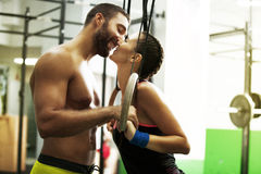 Young fit couple. Younf fit couple kissing in the gym Royalty Free Stock Photo