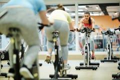Girls on fitness bikes royalty free stock image
