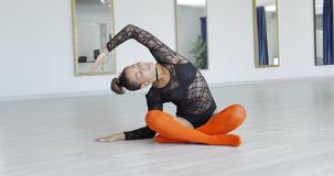 Young sportive dancer stretching in studio stock video