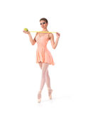 A young and fit female ballet dancer in an orange dress Royalty Free Stock Image