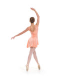 A young and fit female ballet dancer in an orange dress Royalty Free Stock Images