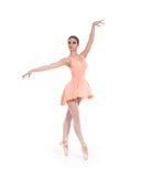 A young and fit female ballet dancer in an orange dress Stock Photography
