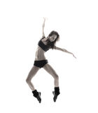 A young and fit female dancer jumping in lingerie Royalty Free Stock Image